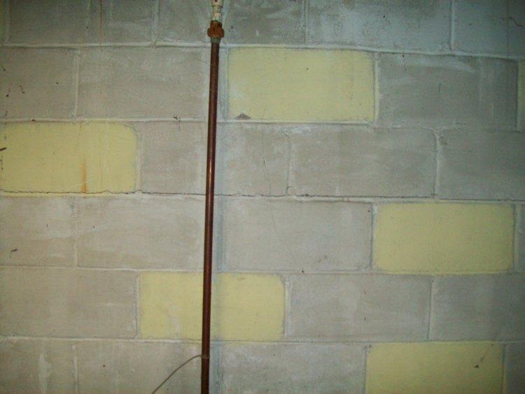 Bad cinder block walls in basement for Block basement walls
