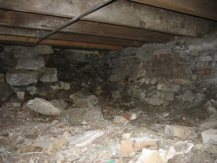 Crawl space broken supports seal dirt floor and trash Crawl space flooring