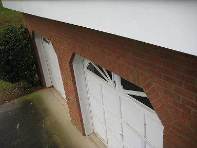 Convert 2 garage doors into one for Convert two door garage into one
