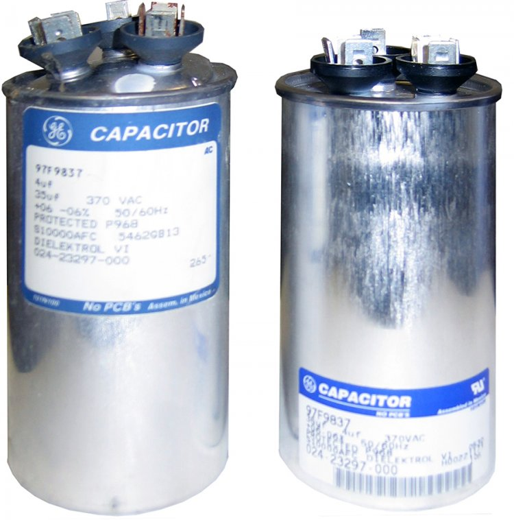 Capacitors give an extra boost to electrical motors when starting under a load condition. The capacitor attaches to the motor's electrical circuit through two metal