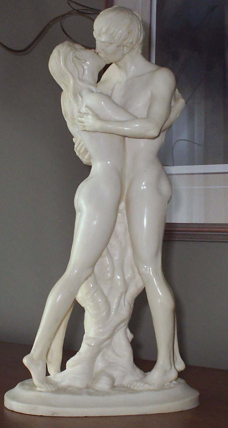 It is a nude of a male and female kissing. It is white and quite heavy and ...