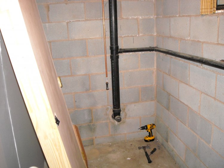 Installing toilet into basement through sewer pipe for Basement bathroom with septic tank