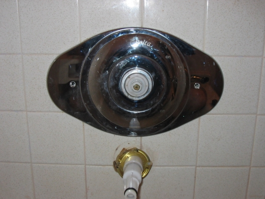 Removing delta bathtub shower single handle faceplate